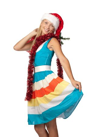 Smiling shopping girl in red christmas cap over white background photo