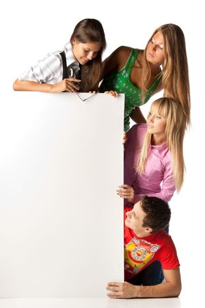 notice: The group of young people holds the empty board for the text on a white background. Stock Photo