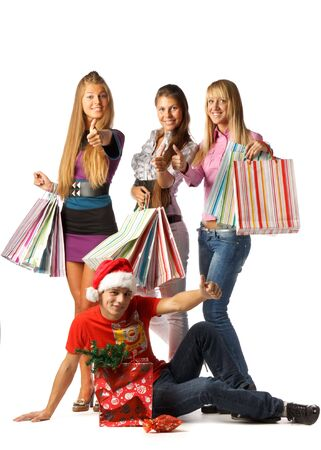 Group of happy young people with shopping bags over white background photo