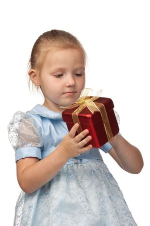 The beautiful little girl with gift on a white background. photo