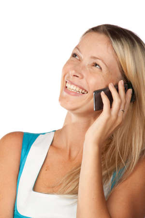The young woman talks by a mobile phone on a white background. photo
