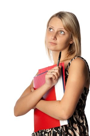 The young successful businesswoman with folders for documents in hands looks at imagined object on a white background. photo