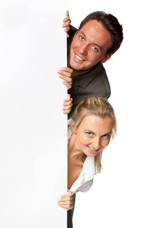 Pretty businesswoman and businessman hold an empty billboard over white background. Stock Photo - 5643541