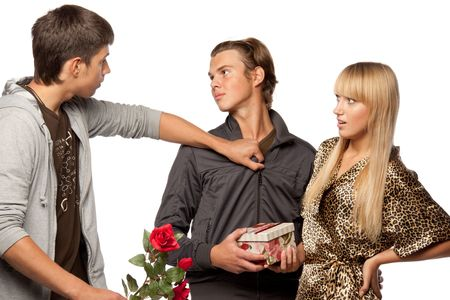 suddenness: Young  men find out among themselves relations because of the girl. Double appointment. Stock Photo