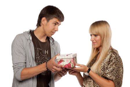 The young enamoured man gives a gift to the girlfriend on a white background. Stock Photo - 5646191