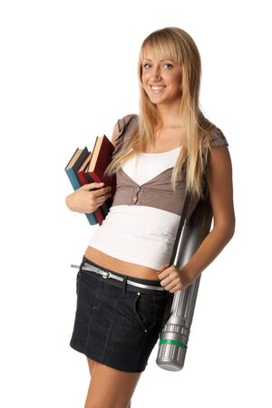 The attractive student stands with books and a tube on a white background. Stock Photo - 5646172