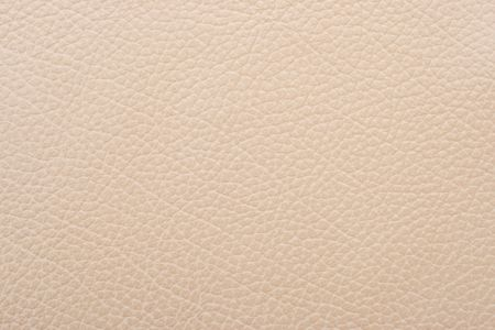 structured: Natural qualitative beige leather texture. Close up.