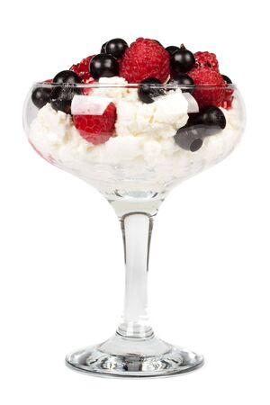 Fresh cottage cheese with appetizing berries in a glass vase on a white background. photo