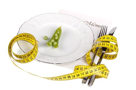 Pea and measure tape on a plate over white background Stock Photo - 5663653