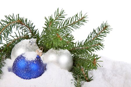dangling: Christmas toy on a snow over white background Stock Photo