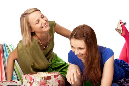 Two pretty girls discuss purchases on a white background photo