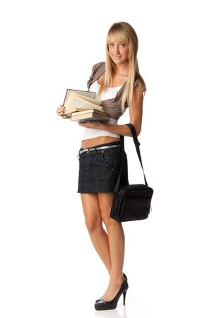 The attractive student stands with books and a bag on a white background. The student. Stock Photo - 5689942