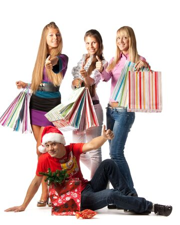 Group of happy young people with shopping bags over white background Stock Photo - 5689920