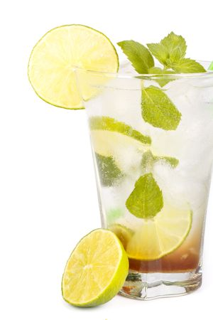 Mojito cocktail with lime, mint leaves and ice on a white background photo
