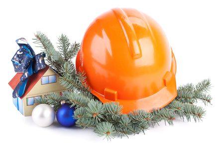 Hard hat, fir-tree branches, Christmas toys and small house on a white background. Stock Photo - 5795736