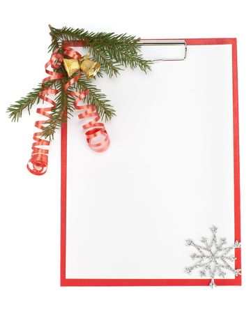 Clipboard with blank paper for messages, snowflakes and Christmas ornaments on a white background photo