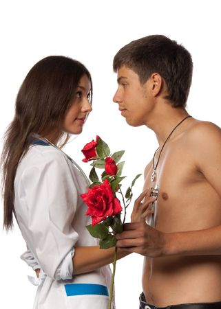 The female doctor listens to heart of the  male  patient through a stethoscope on a white background. photo