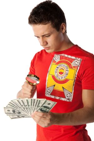 The young man with money and a magnifier on a white background. Stock Photo - 5909406