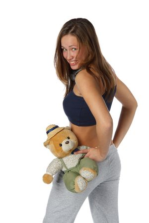 The beautiful girl with a toy bear in rollerskates on a white background. photo