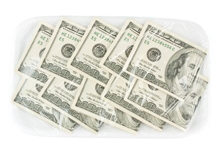 One hundred dollars banknotes on a tray photo