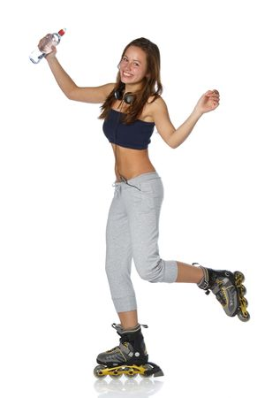 The beautiful girl with water bottle in rollerskates on a white background. photo