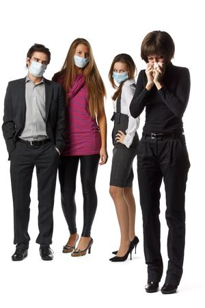 The girl with handkerchief and healthy people in individual protective masks on a white background. Reklamní fotografie - 5947133