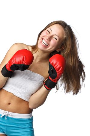 girl action: Sporty girl in red fighting gloves on a white background.
