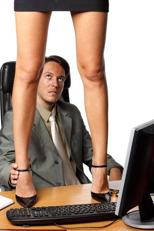 sexy secretary: Sexual harassment. Sexy woman standing on desktop before businessman on a white background. Stock Photo