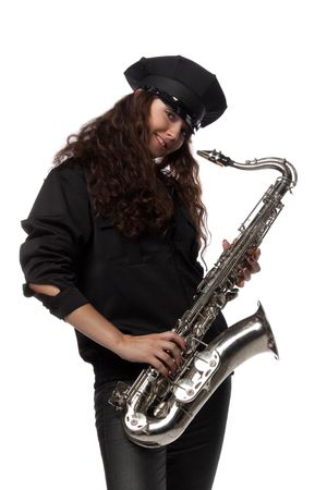 Sexy girl in a uniform of the security guard with a saxophone on a white ackground photo
