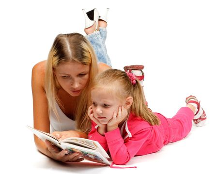 Young mum reads the interesting book to the daughter on a white background. Stock Photo - 6087598