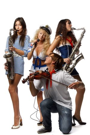 Trendy group of young people with musical instruments on a white background photo