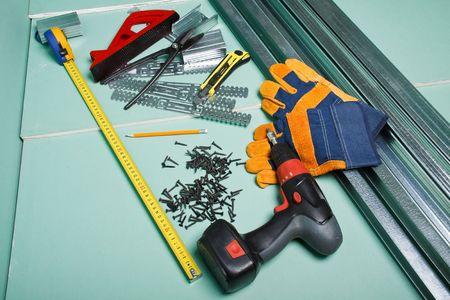 Plasterboard and various building tools.  Apartment repair. photo