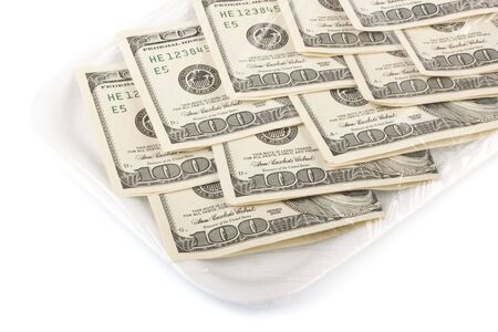 One hundred dollars banknotes on a styrofoam tray photo