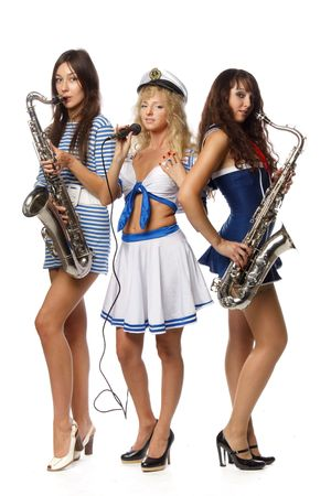 Trendy group of sexy girls with musical instruments on a white background photo
