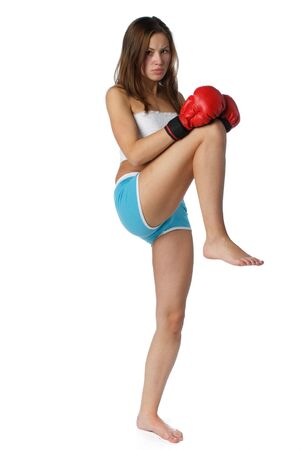 female fighter: Sporty girl in red fighting gloves on a white background.