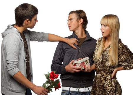 Young  men find out among themselves relations because of the girl. Double appointment. photo