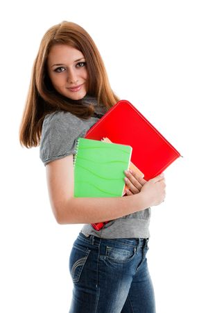 The beautiful girl stand with coloured writing-books on a white background. The student. Stock Photo - 6381564
