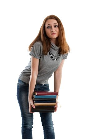 The attractive student stands with books on a white background. The student. Stock Photo - 6381570
