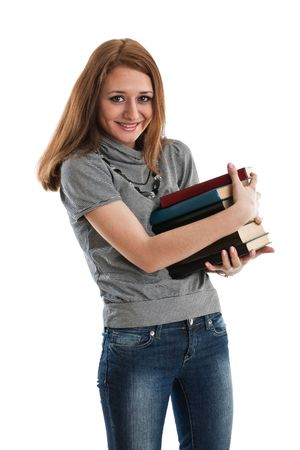 The attractive student stands with books on a white background. The student. Stock Photo - 6381567