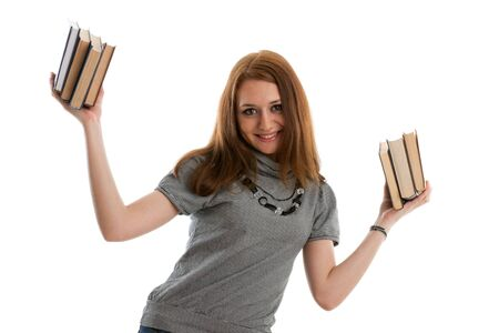 The attractive student stands with books on a white background. The student. Stock Photo - 6381568