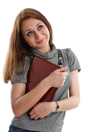The attractive student stands with the laptop on a white background. photo