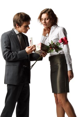 unexpectedness: The young enamoured man gives a gift to the girlfriend on a white background.