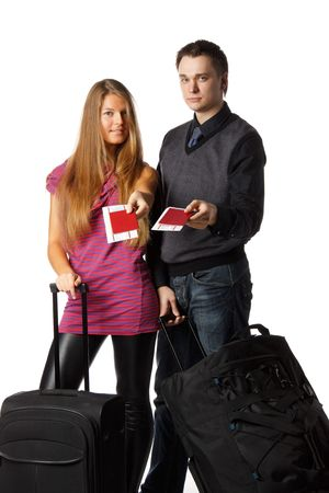 Happy young family with suitcases and tickets on a white background. Vacation. photo