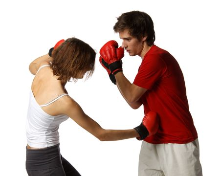 female boxer: Sporty couple in red fighting gloves on a white background. Stock Photo