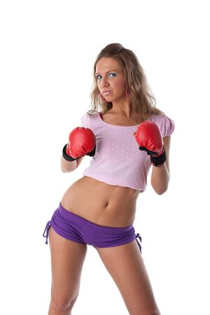 Sporty girl in red fighting gloves on a white background. Stock Photo - 6408724