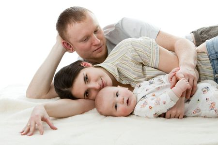 Happy family.  Father, mother and  sweet  baby on a white background. Stock Photo - 6427581
