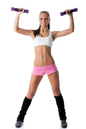 The beautiful sports girl with dumbbells on a white background. Training. Stock Photo - 6427695