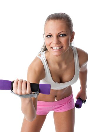 The beautiful sports girl with dumbbells on a white background. Training. Stock Photo - 6427629
