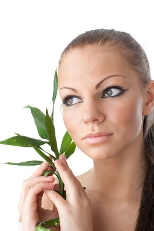 The attractive girl with a bamboo branch on a white background Stock Photo - 6427669