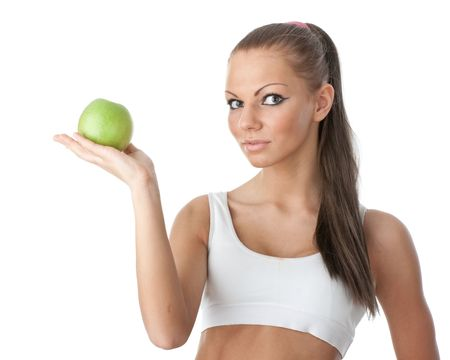 Young beautiful girl with apple in hands on a white background. Healthy food concept Stock Photo - 6427693